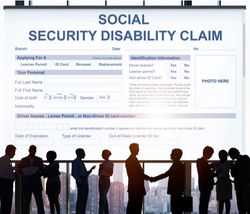 A Social Security Disability Claim Form with people in front of it.